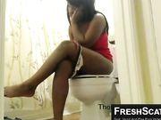 Something black girl pooping on toilet